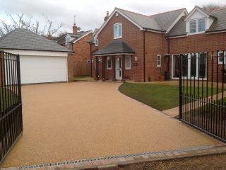 Large Bristol driveway surfaced in resin with appropriate drainage at drive parameter