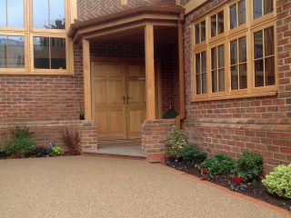 Perfectly coloured resin driveway working well against the colours of this property