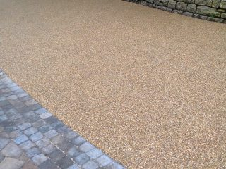 Detail of block paving and resin driveway together