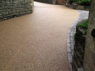 Long access road with new resin driveway