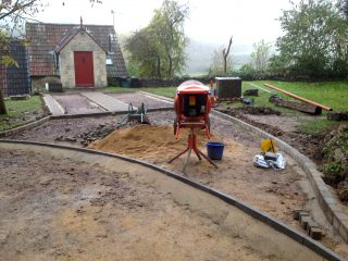 The driveway under construction with the drainage and blocks in place