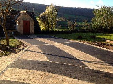 The final block and tarmac driveway with beautiful rolling hills behind